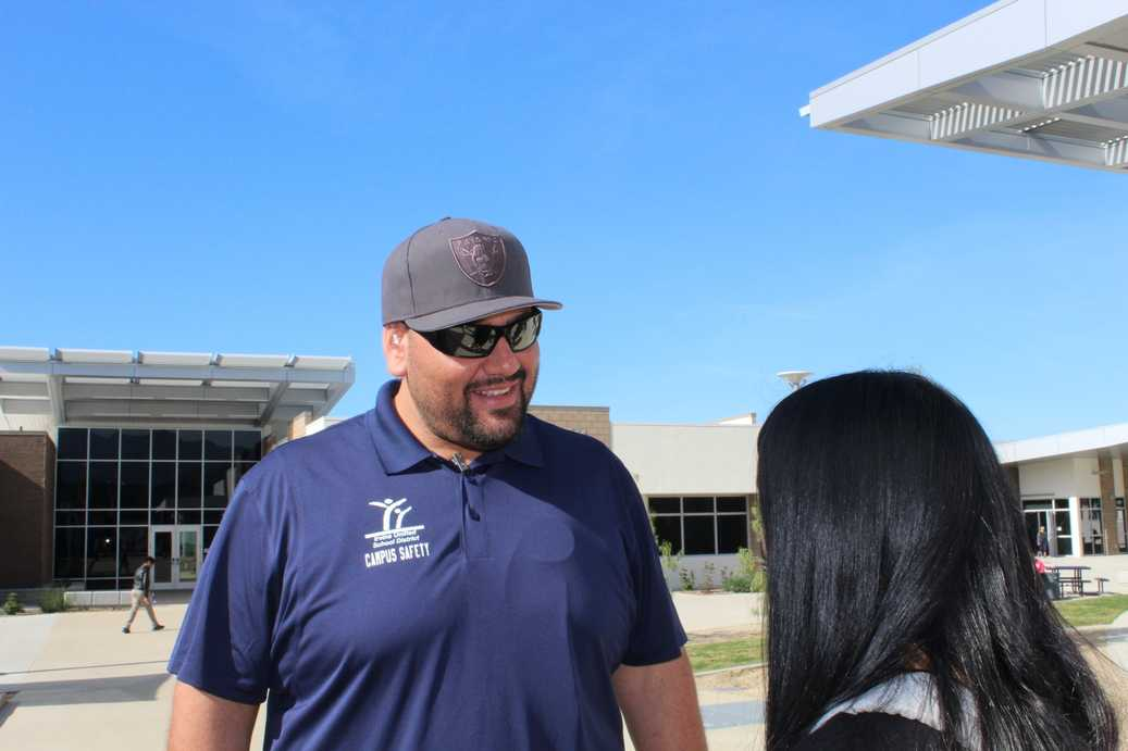 George Mares laughs with student Allison Shi during break.