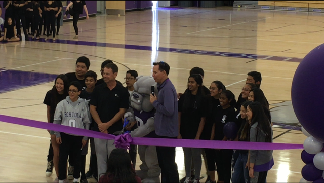 Principal+John+Pehrson+and+Superintendent+Terry+Walker+help+cut+the+ribbon+at+the+Student+Dedication+Ceremony.+