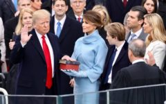 Donald J. Trump takes the oath of office on Jan. 20, surrounded by family and notable Republican politicians.