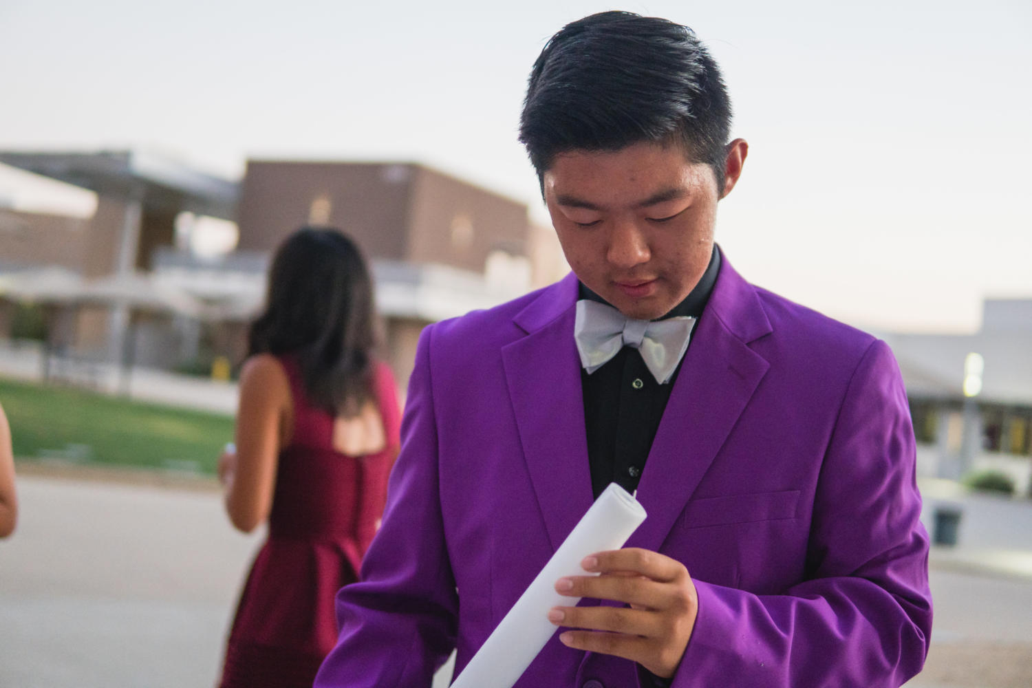 Hercules house president Anthony Lu checks the foam glow stick lights before the Forthcoming dance.