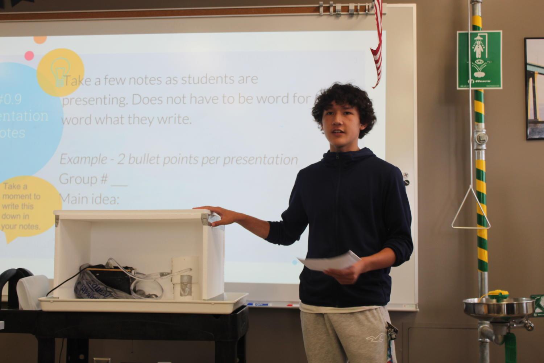 Sophomore Eaden Haresco describes his group's hydro-refrigeration model.