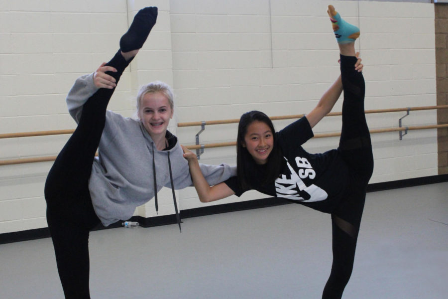 Freshmen+Alina+Medvedeva+%28left%29+and+Nena+Oshita+%28right%29+complete+twin+leg+holds+in+the+dance+practice+room.+