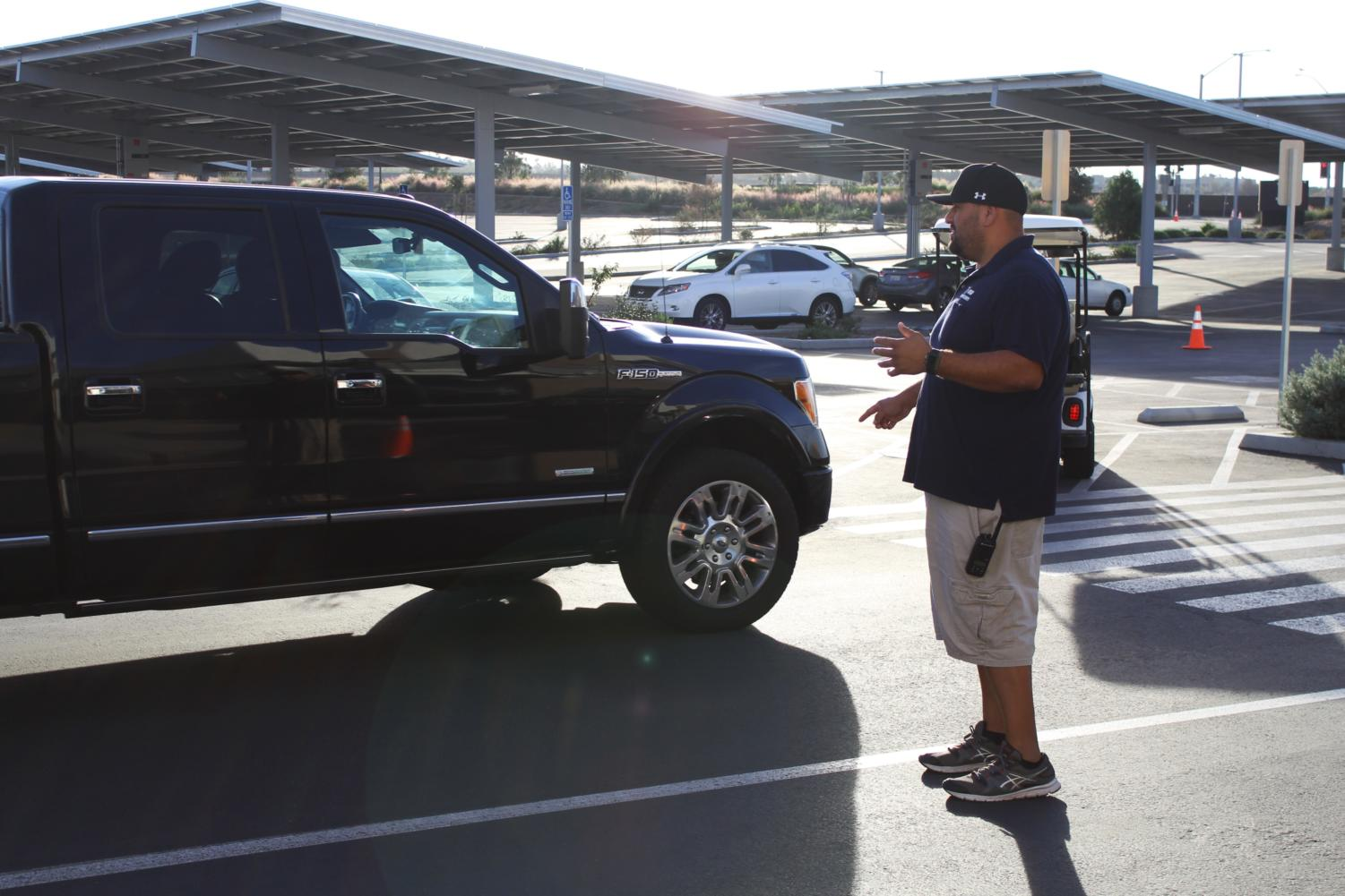 Campus control assistant George Mares ensures that drivers in our school parking lot are safe to prevent any injuries.