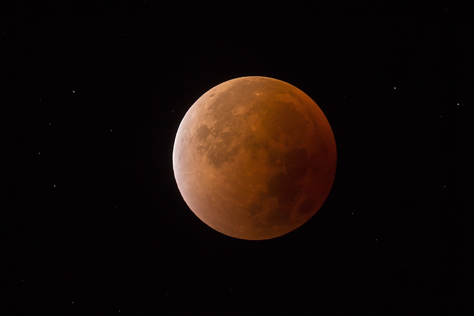 In addition to the red tint of the moon caused by the lunar eclipse, the elliptical orbit of the supermoon allows it to appear 14 percent larger and up to 30 percent brighter.
