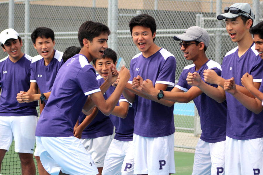 +Sophomore+Kameran+Mody+fist-bumps+his+team+as+he+runs+down+the+lineup+at+the+start+of+the+match+in+order+to+increase+team+spirit.