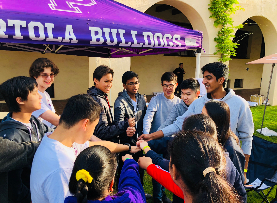 The Science Olympiad team gathers for a pep talk before the competition.