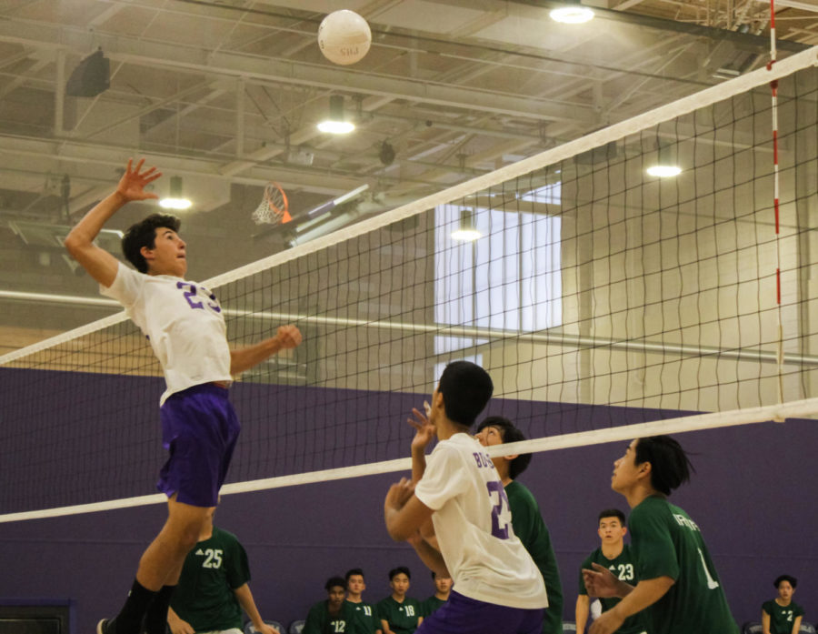 Kaveh+Wojtowich+returns+the+ball+to+the+opponents+with+a+spike+and+scores+a+point+for+the+team.