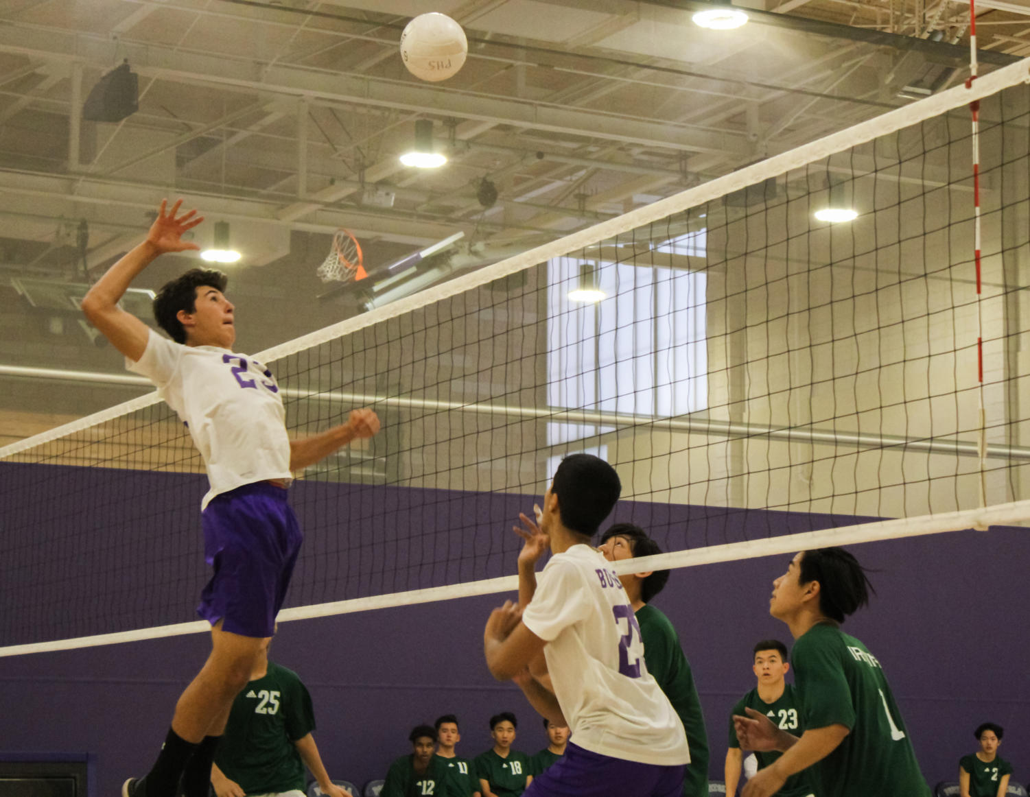 Kaveh Wojtowich returns the ball to the opponents with a spike and scores a point for the team.