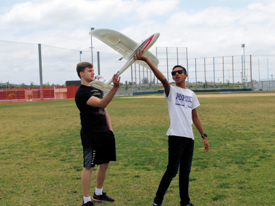 Mike+Nassif+shows+Nick+Medvedev+how+to+launch+a+remote+controlled+airplane.
