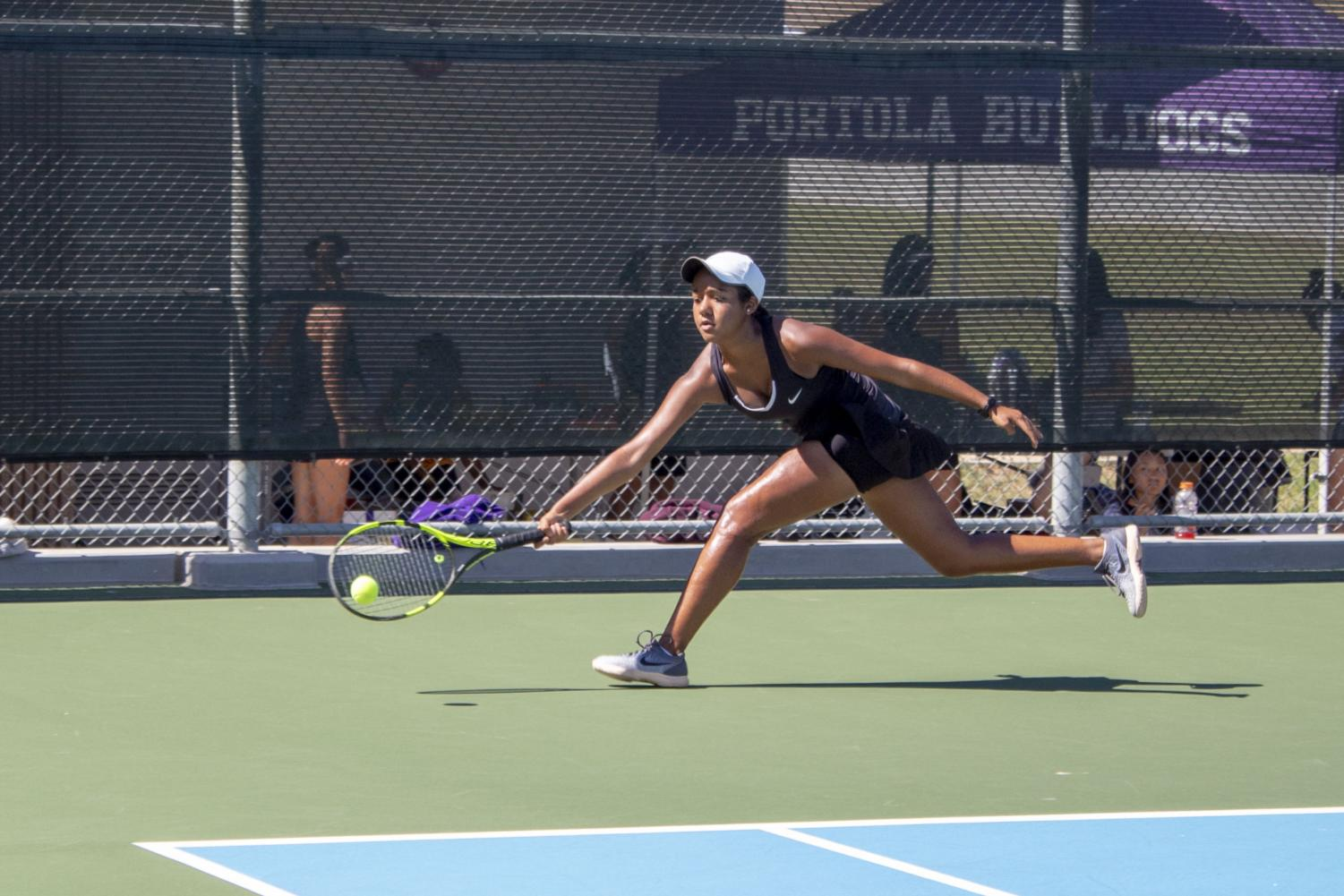 Just getting there in time, freshman Saachi Pavani returns a powerful crosscourt shot to win the point.
