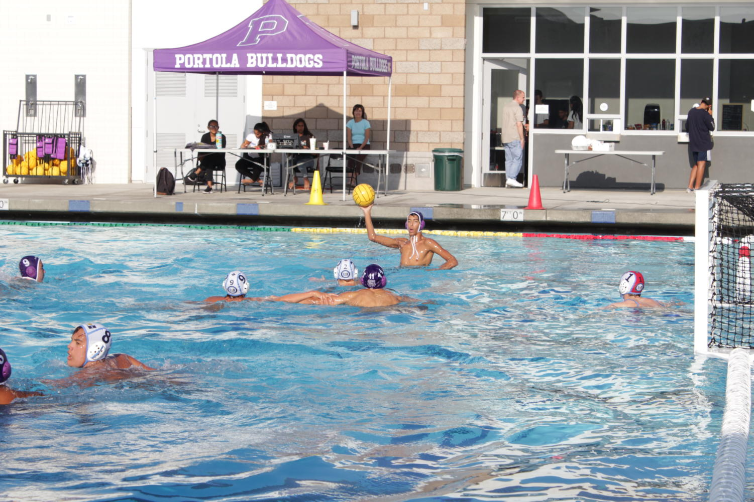 Boys' water polo captain Belal Ibrahim takes aim at University High's goal during second half of the game.
