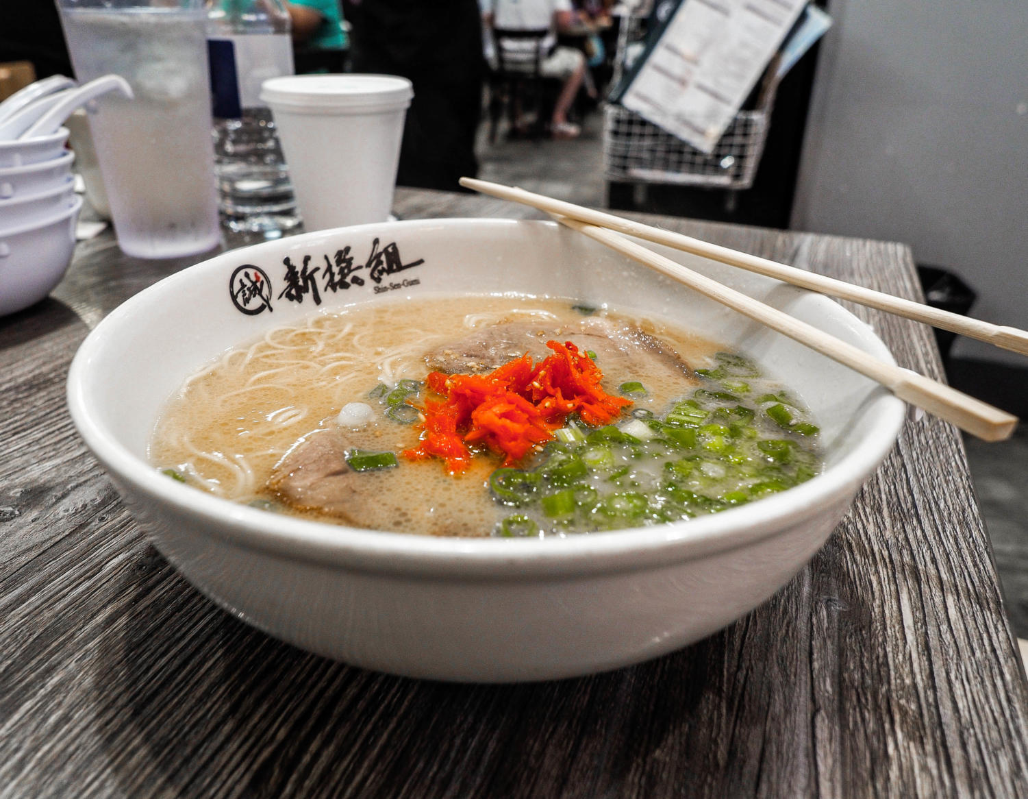 One of Shin-Sen-Gumi's popular dishes, Hakata Ramen, featres a deep and flavorful soup base topped with noodles customized to cook the way you order it. The ramen also comes with pieces of pork belly, green onion and ginger.