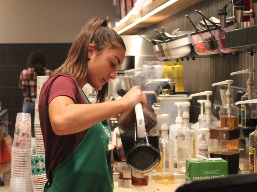 From+five+p.m+until+nine+p.m%2C+junior+Neha+Scott+dons+her+classic+green+Starbucks+apron+and+prepares+drinks+for+her+customers%2C+adding+intricate+swirls+of+sweet+syrup+and+puffs+of+whipped+cream.+In+addition%2C+she+mans+the+cash+register+and+baristas%2C+gracefully+carrying+out+her+heavy+workload.++