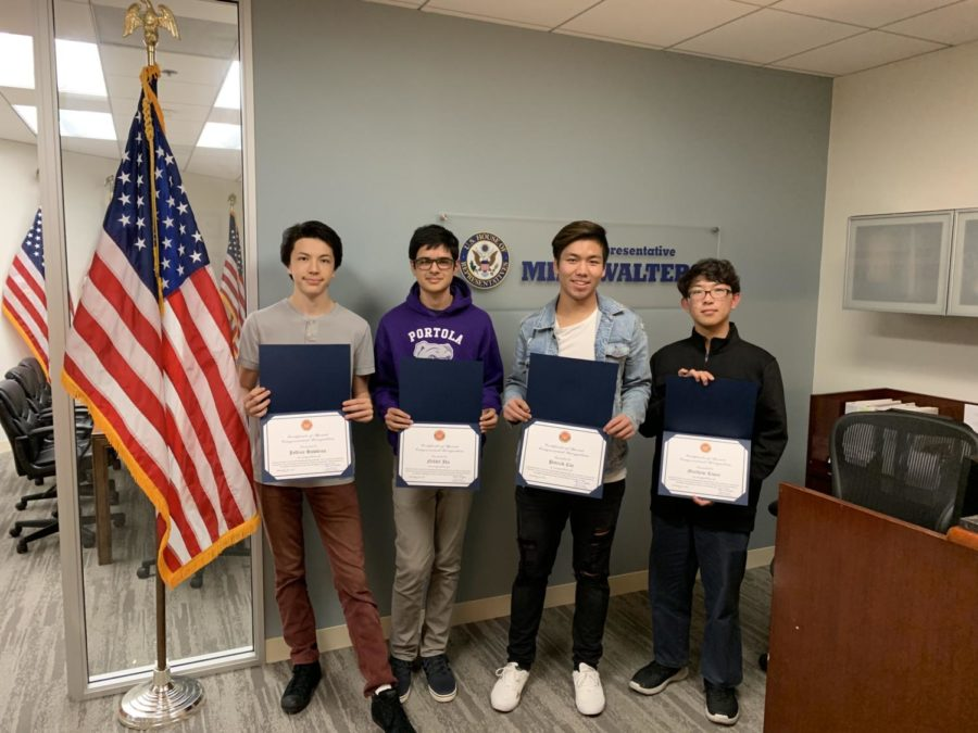 Brian+Hawkins%2C+Nikhil+Jha%2C+Patrick+Cui+and+Matthew+Kwon+received+the+Congressional+App+Challenge+award+on+Nov.+30+for+their+work+on+Portolapp%2C+which+was+built+to+help+students+with+the+no+bell+system.