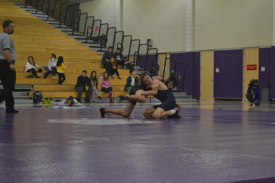 Sophomore+Jackson+Cooper+performs+a+sprawl+on+his+opponent+in+an+effort+to+take+him+down.