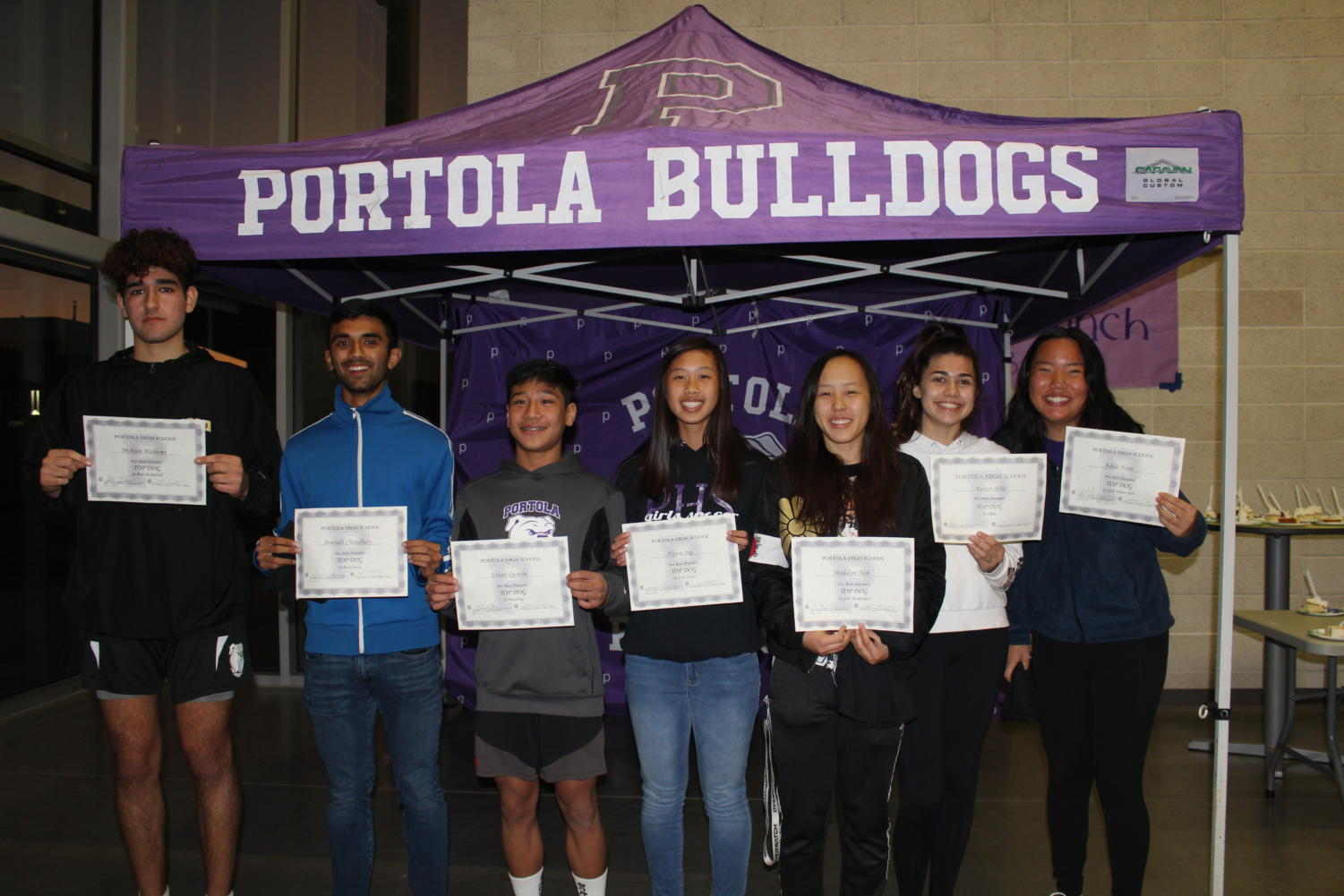 Winter Top Dog award recipients lined up after a night of food and speeches in their honor. Athletes include: junior Mohsen Hashemi, junior Anirudh Chaudhary, freshman Ethan Qureshi, junior Alyssa Ing, junior Madelyn Noh, sophomore Kaitlyn Miller and sophomore Adele Yoon.
