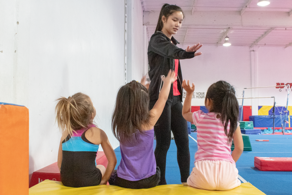 Junior Alene Hata coaches preschoolers at Wildfire Gymnastics Tustin every Saturday from 9:30 until 12:10, patiently introducing children to gymnastics for the first time.