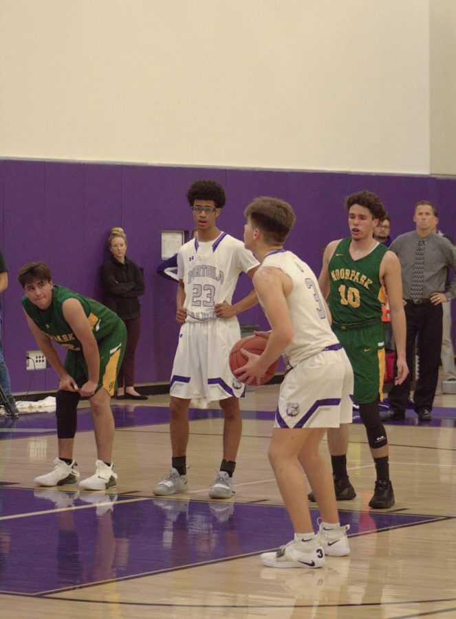 Junior+and+point+guard+Robert+Giraldy+prepares+to+take+a+free+throw+in+hopes+of+decreasing+Moorpark+High%E2%80%99s+lead+in+the+third+quarter.+%0A