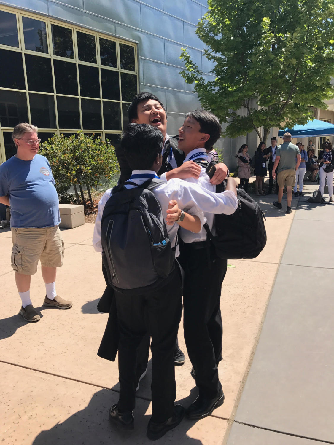 Freshmen Henry Liu, Kevin Lu, and Sai Kuppili celebrate being one of very few selected to move in the finals round.