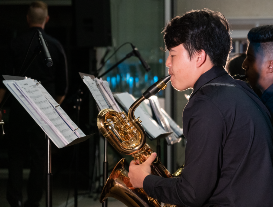 As+the+finale+of+the+concert%2C+freshman+Garrett+Lee+showcases+his+saxophone+skills+in+musicality+and+improvisation+with+the+jazz+classic+%E2%80%9CMambo+Inn%2C%E2%80%9D+a+song+highlighting+two+unique+instruments%3A+timbales+and+congas.