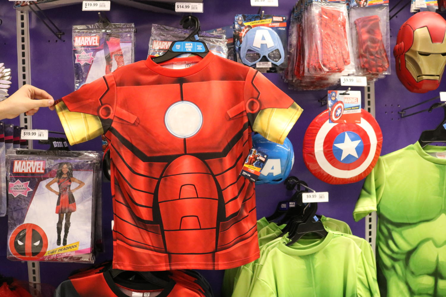 Recreating Iron Man is just as easy as purchasing this 9.99 t-shirt from a local Party City. The t-shirt can easily be paired with additional decorations like an Iron Man mask for 4.99 at the same location.