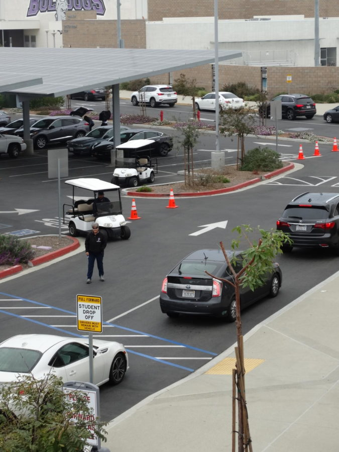 Campus+Control+Assistants+Kathy+Elgohary+and+George+Mares+supervise+the+drop-off+line+to+keep+a+constant+flow+of+traffic.+This+year%2C+there+are+more+student+drivers+at+Portola+High+than+ever%2C+causing+more+traffic+to+build+up+around+campus+and+on+Irvine+Blvd.+in+the+morning.