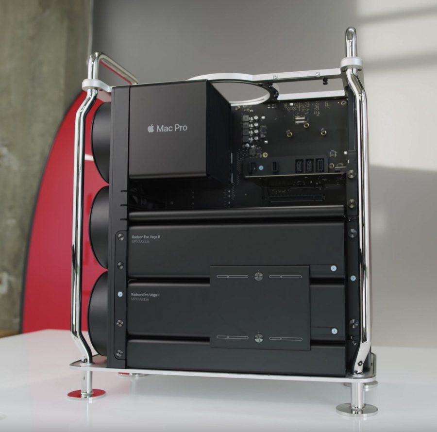 A+Mac+Pro+with+its+case+removed+shows+the+internals.+From+top+to+bottom%2C+there+is+the+CPU+heat+sink%2C+Afterburner+card%2C+two+GPU+units+and+power+supply.