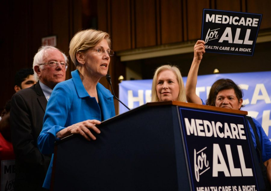 Sen.+Elizabeth+Warren%2C+D-Mass.%2C+speaks+on+the+platform+of+Medicare+for+All%2C+which+raises+taxes+for+middle+and+upper-class%2C+but+brings+the+overall+costs+of+affording+healthcare+down.%0A