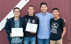 "Teacher Anthony Pham, senior Benjamin Kim and junior Ethan Ho show the award for ""Preparing Student-Athletes for the Next Competition: Esports."""