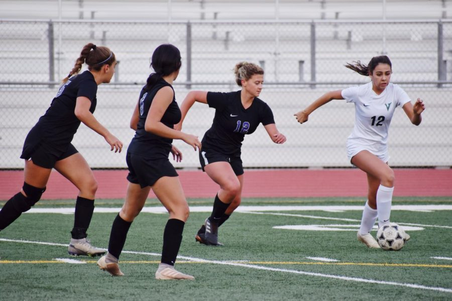 Junior+Peyton+Weidner+sprints+to+intercept+the+ball+and+proceeds+to+score+the+first+goal+against+the+Vaqueros+during+the+first+half.