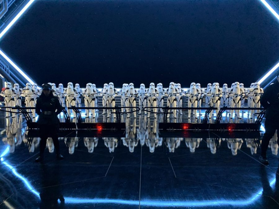 As+guests+get+ready+to+board+the+ride%2C+an+army+of+Stormtroopers+are+there++guarded+by+cast+members+dressed+as+soldiers+for+the+First+Order+to+contribute+to+the+theming+of+the+ride.%0A
