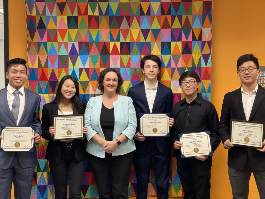 Congresswoman+Katie+Porter+%28third+from+the+left%29+awarded+seniors+Patrick+Cui%2C+Stephanie+Zhang%2C+Brian+Hawkins%2C+Matthew+Kwon+and+Jimmy+Kang+with+a+certificate+to+recognize+their+achievements.+