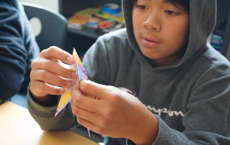 Freshman Caden Wu uses intricate folds and cuts to create a crane out of colored paper. The orizuru, or paper crane, is considered the most classic Japanese origami sculpture and is associated with celebration and hope.