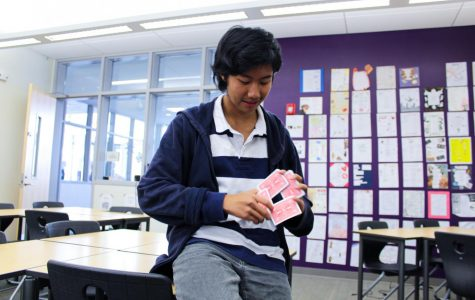 After months of diligent practice, sophomore and Magic Club president Desmond Wong performs the famous card spring trick that has been a long-standing favorite in magic history. To engage people who are unfamiliar with magic, club meetings normally consist of members staging close up magic tricks in a parlor-like setting.