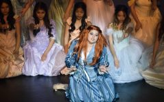 """Jealous step-sister Charlotte (sophomore Paris Suttle) began act two with """"Stepsister's Lament"""" accompanied by the ladies of the court. Together they questioned, """"Why would a fellow want a girl like her?"""" after seeing Prince Topher dance with and show interest in a disguised Cinderella at the ball."""