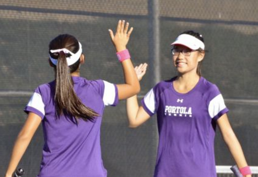 Doubles+partners+Kaylee+Seo+and+Kelly+Zhang+celebrate+after+scoring+a+point.%0A