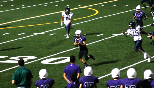 #24 running back Kai Horn gains yardage on a quick catch.