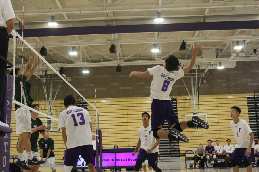 +%238+freshman+Andy+Son+jumps+to+spike+a+ball+against+Irvine+High.+