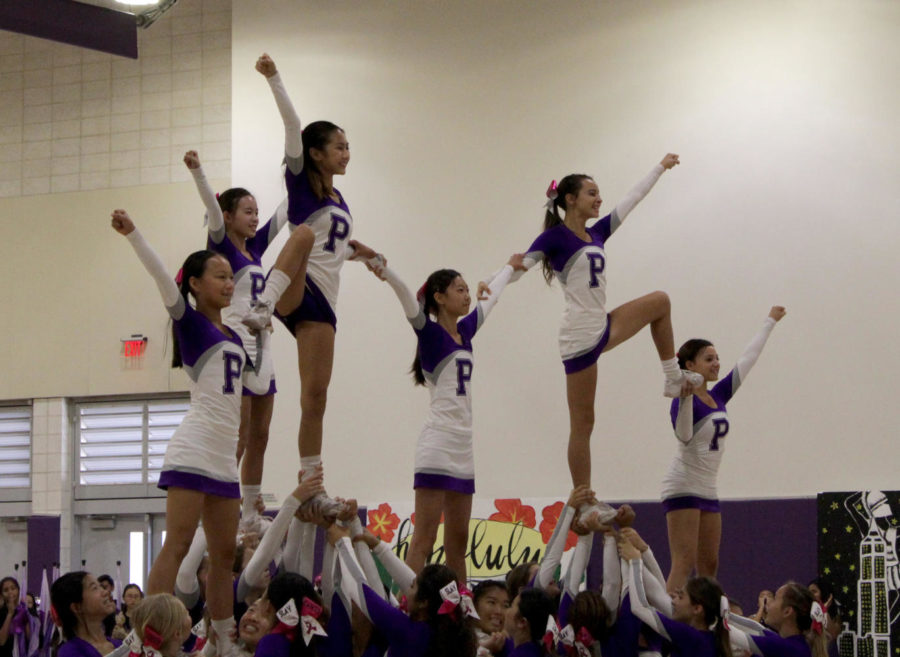 Cheerleaders+Leyna+Liu%2C+Vivian+Lin%2C+Jessalyn+Nguyen%2C+Mary+Lu%2C+Ryan+Aguilar+and+Yarden+Gilat+hit+the+mark+in+their+final+formation.