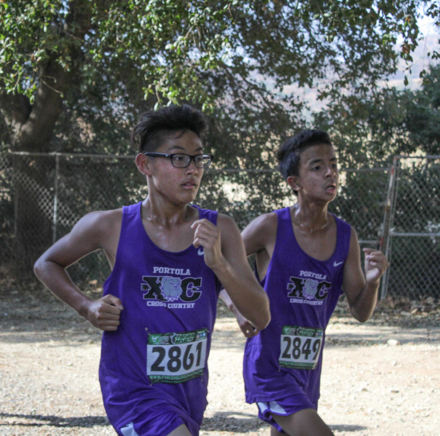 Freshmen Kensay Sato and Damian Vu near the end of the three-mile course.