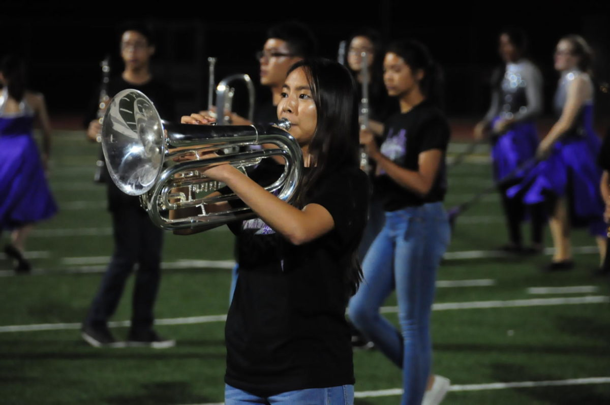 "Baritone section leader Stephanie Tang plays a solo during the marching band performance of ""Pure Imagination."