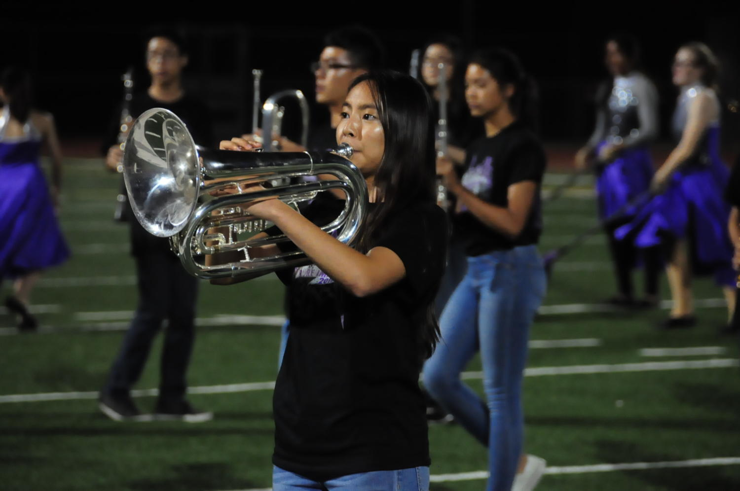 """Baritone section leader Stephanie Tang plays a solo during the marching band performance of """"Pure Imagination."""