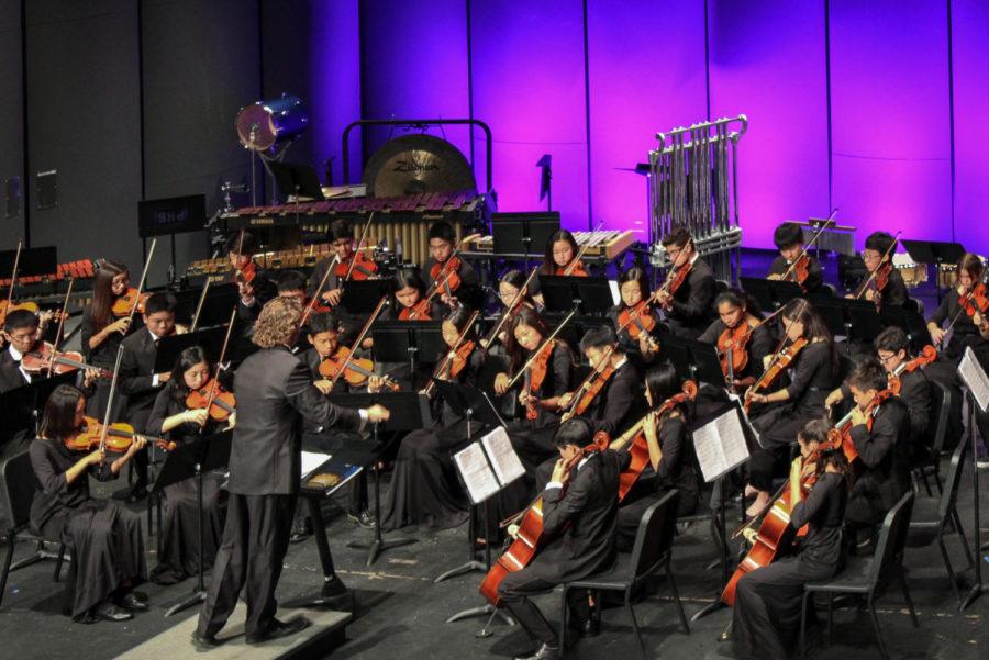 String+Orchestra+plays+%22Mythos%22+under+the+direction+of+Desmond+Stevens.