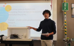Sophomore Eaden Haresco describes his group's hydro-refrigeration model.