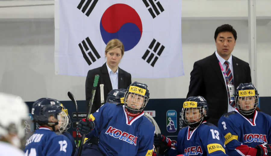 Former ice hockey player and coach Sarah Murray oversees the hockey game at the practice Olympics match against Sweden.