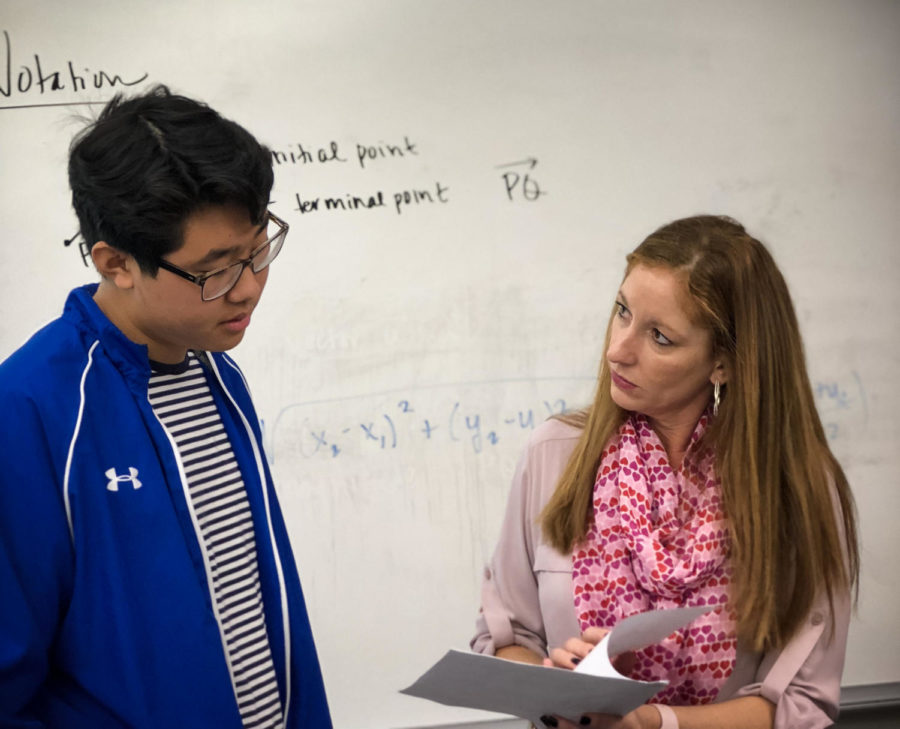 Continuing her teaching in Office Hours, Shelley Godett explains the answers to homework questions with sophomore Joshua Kwon.