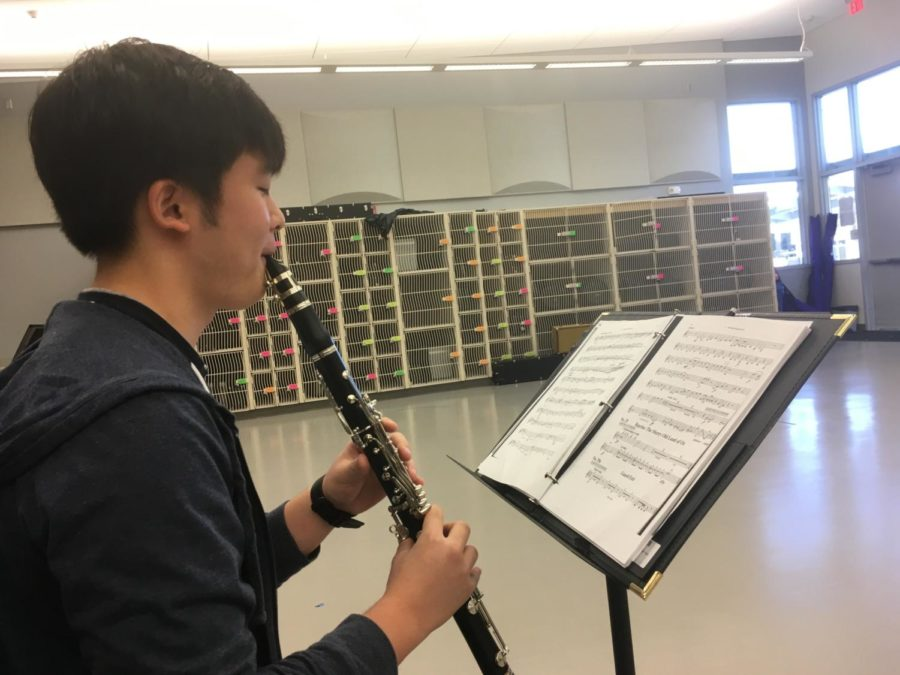 Sophomore Brett Shin takes time outside of class to practice his pit orchestra music in order to be prepared for the rehearsals.