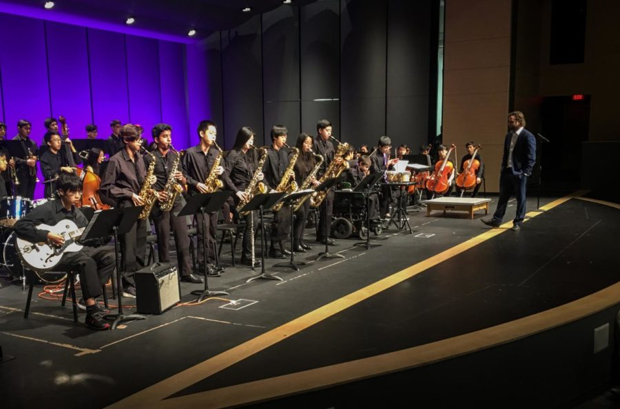 The+saxaphones+perform+%22Hay+Burner%22+at+the+assembly+accompanied+by+guitarist+and+sophomore+Larry+Wu.+
