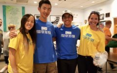 Sophomores Madelyn Noh, Justin Tam and Shawyan Rooein with world history teacher Natasha Schottland smile with their volunteer gloves in hand.
