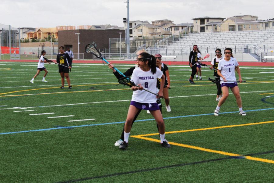 Freshman Nika Karimi tries to break through the opponent team's tight defense.